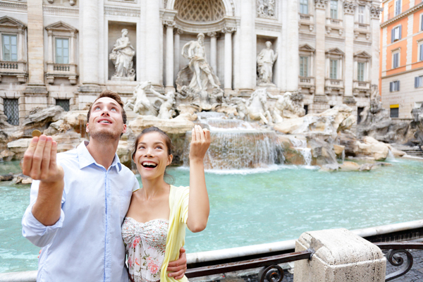 throwing-coins-trevi-fountain-italy